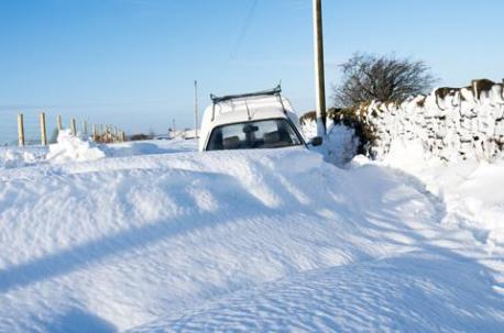 Van buried in snow